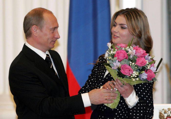 https://dailyentertainmentnews.com/wpgo/wp-content/uploads/2013/06/Alina-Kabaeva-Vladimir-Putin-pics.jpg