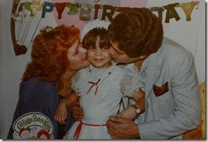 Jose Martinez and his wife, Idalia, kiss Joselyn