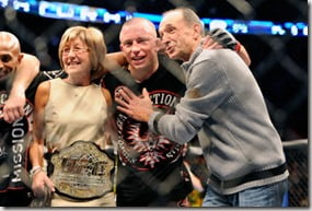 Nov 17, 2012; Montreal, QC, Canada;  Georges St-Pierre poses for a photo with his parents Pauline and Roland after winning the Welterweight Championship bout against Carlos Condit at UFC 154 at the Bell Centre.  St-Pierre defeated Condit by unanimous decision.  Mandatory Credit: Eric Bolte-US PRESSWIRE