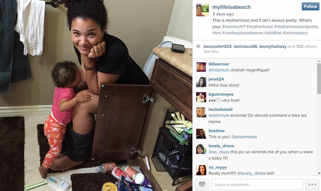 Elisha Wilson Beach Breastfeeding photo